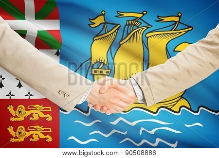Businessmen Handshake With Flag On Background - Saint-pierre And Miquelon