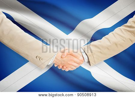 Businessmen Handshake With Flag On Background - Scotland