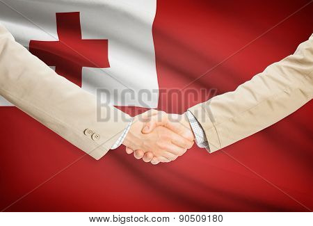 Businessmen Handshake With Flag On Background - Tonga