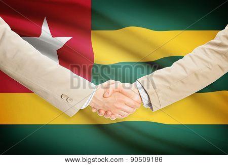 Businessmen Handshake With Flag On Background - Togo