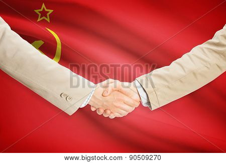 Businessmen Handshake With Flag On Background - Ussr - Soviet Union