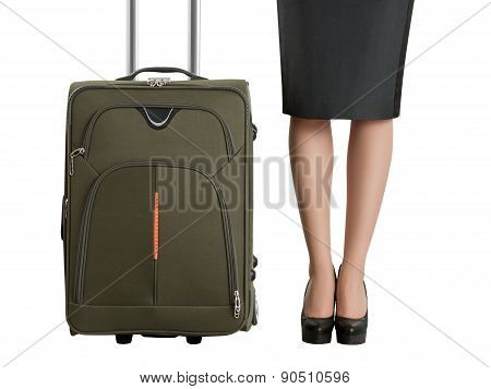 Beautiful woman's legs and travel suitcase