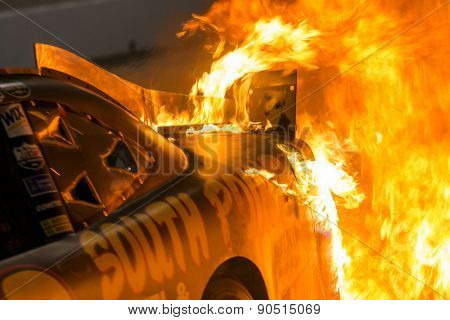 Richmond, VA - Apr 24, 2015: Brendan Gaughan (62) pulls into the pits on fire during the ToyotaCare 250 at Richmond International Raceway in Richmond, VA.