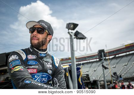 Bristol, TN - Apr 17, 2015:  Darrell Wallace Jr (6) watches his crew work before a practice session for the Drive to Stop Diabetes 300 at Bristol Motor Speedway in Bristol, TN.
