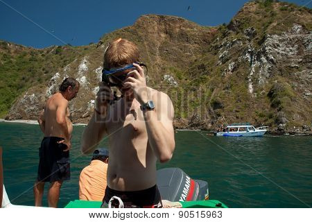 Unidentified tourists enjoying a daytrip snorkeling in beautiful paradise beach, Salango island. Man