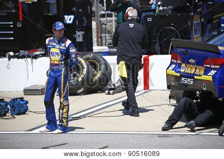 Richmond, VA - Apr 24, 2015:  Chase Elliott (25) watches his crew work on his car during a practice session for the Toyota Owners 400 at Richmond International Raceway in Richmond, VA.