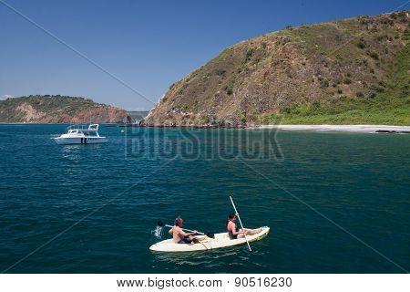 Unidentified tourists enjoying a daytrip kayaking in beautiful paradise beach, Salango island. Manab