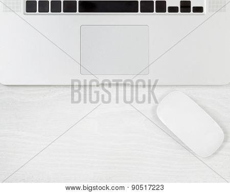 Clean White Wooden Desktop With Computer And Mouse