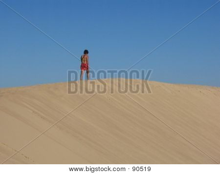 Woman Walking In The Dunes