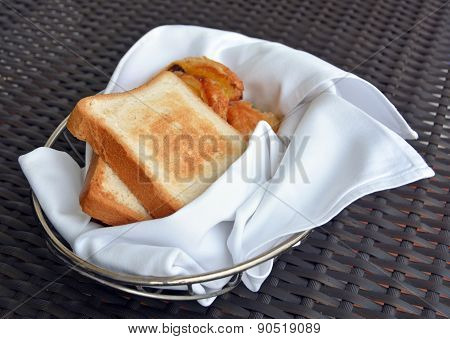 Basket Of Freshly Baked Pastries And Toast  Including Pain Aux Raisins