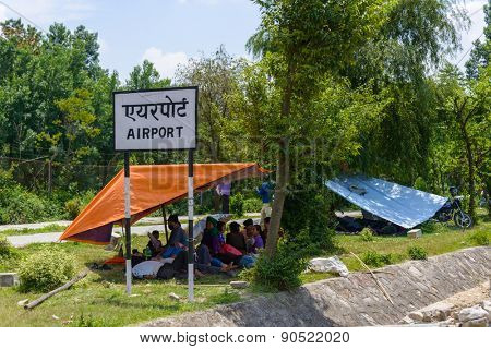 KATHMANDU, NEPAL - MAY 13, 2015: People camp just next to Kathmandu international airport after a 7.3 earthquake hit Nepal on May 12, 2015.