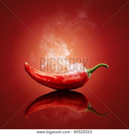 Hot red chili smoking or steaming with reflection