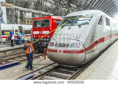 Worker Cleans The Front Windshield Of A Highspeed Train