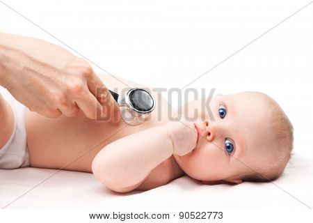 Close-up shot of pediatrician examines three month baby girl. Doctor using a stethoscope to listen to baby's chest checking heart beat. Child is looking at camera sucking hand.