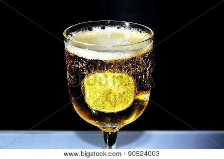 lemon in glass of beer