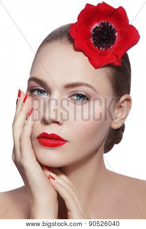 Young beautiful woman with clean make-up, red lips, fancy manicure and red flower in her hand over white background