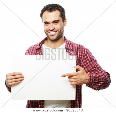 life style  and people concept:young handsome man showing blank signboard, isolated over white background