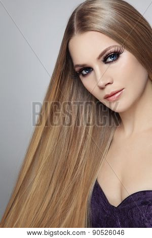 Young beautiful woman with long hair and false eyelashes
