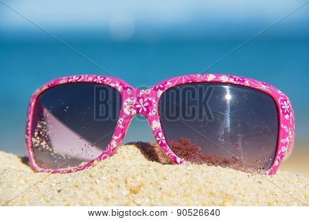 Pink Suglasses On The Sand