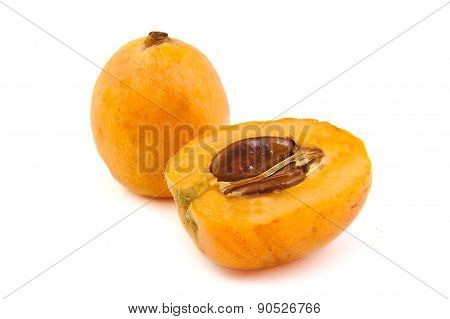 Close up view of some loquat fruit on a white background