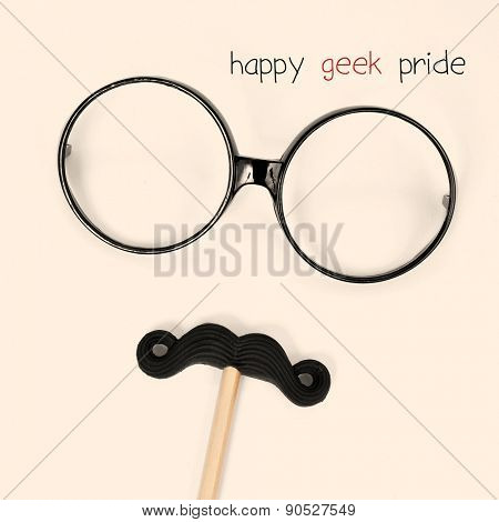 the text happy geek pride and a pair of round-framed eyeglasses and a moustache depicting a man face, on a beige background