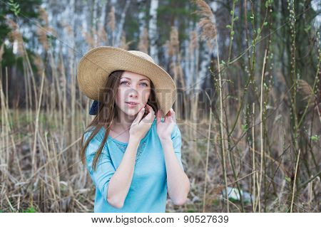 Freckled Woman In Hat Looking At Camera