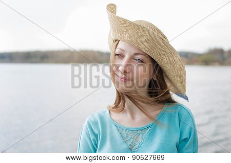Happy Woman In Hat Thinking