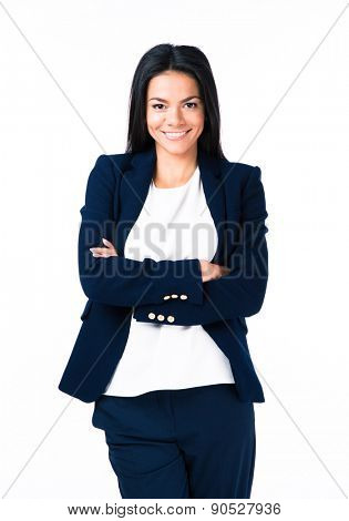 Portrait of a cheerful businesswoman with arms folded over white background. Looking at camera