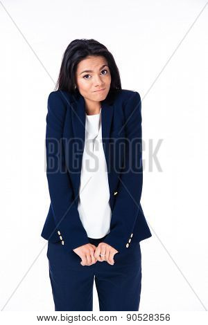 Businesswoman shrugging her shoulders over white background and looking at camera