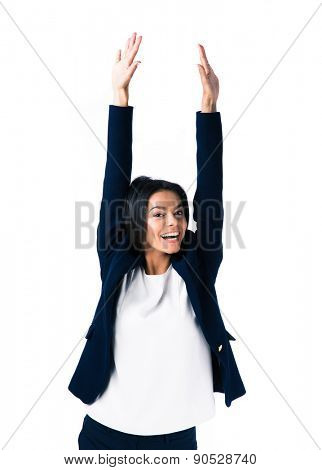 Laughing businesswoman with raised hands up standing over white background. Looking at camera