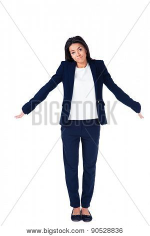 Full length portrait of a businesswoman shrugging her shoulders over white background and looking at camera