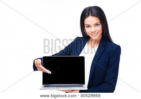 Happy businesswoman presenting something on the laptop over white background. Looking at camera