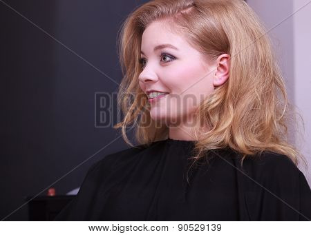 Beautiful Smiling Girl With Blond Wavy Hair By Hairdresser In Beauty Salon