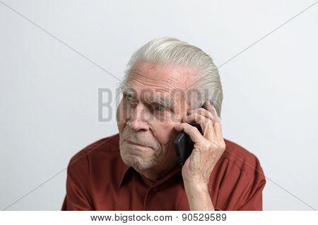 Senior Man Having A Call On Mobile Phone
