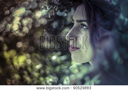Remember, melancholy young girl in a forest with sad gesture
