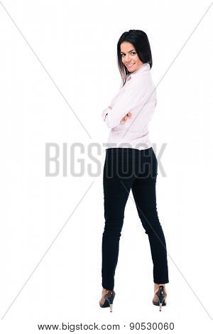Back view portrait of a happy businesswoman standing isolated on a white background and looking at camera