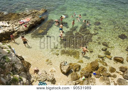 People Bathing On Beach In Rovinj