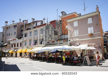 People On Restaurant Terrace In Rovinj