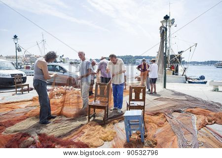 Fishermen With Driftnet In Rovinj