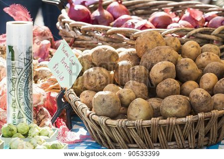 Fresh Organic Yukon Gold Potatoes And Onions At Farmer's Market