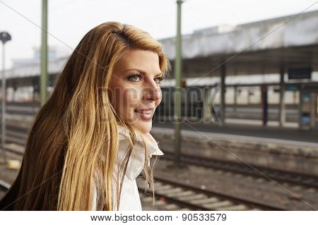 young woman waiting for the train