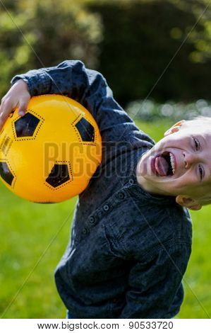 Preschool Child With Soccer Ball