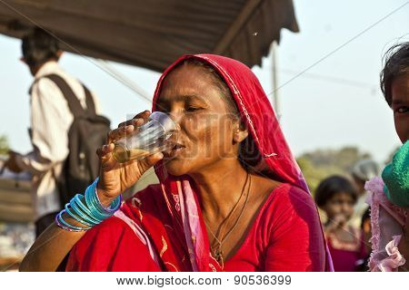 Woman Drinking Tea In The Meena Bazaar In Delhi