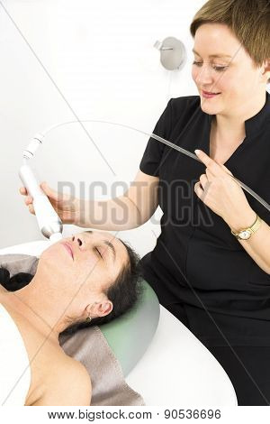 Female client get face treatment at beauty spa