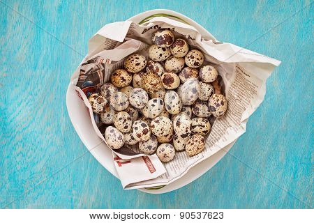 Quail Eggs On A Blue Wooden Background, Top View