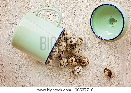 Quail Eggs In Green Metal Cup, 0N Light Color Wooden Background, Top View