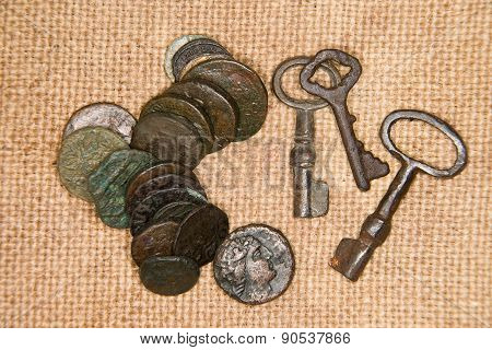 Ancient   Coins With Portraits Of Kings And Keys On The Old Cloth