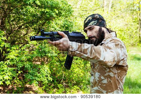 Bearded soldier with a rifle