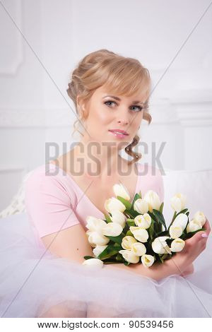 Beautiful Blonde Woman With A Bouquet Of Tulips