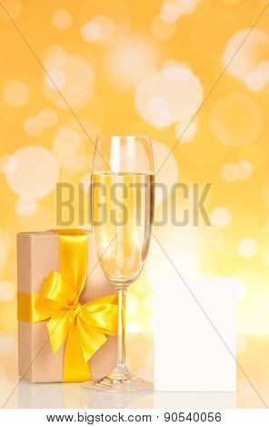 Champagne glass, gift and empty card